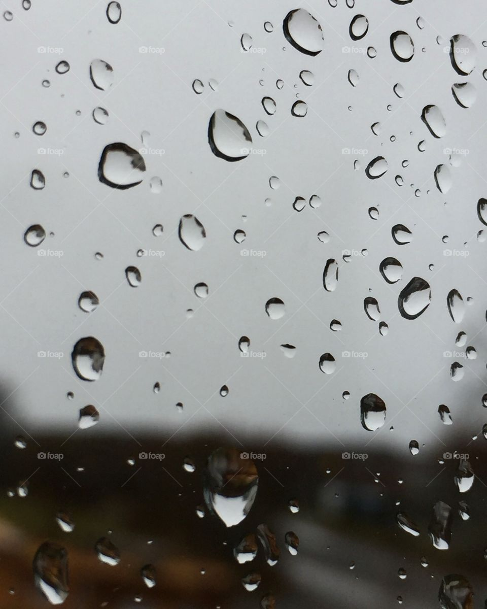 Close-up of water drop on glass window