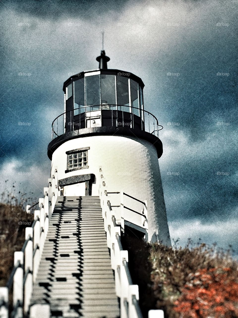 New England Lighthouse under gray skies