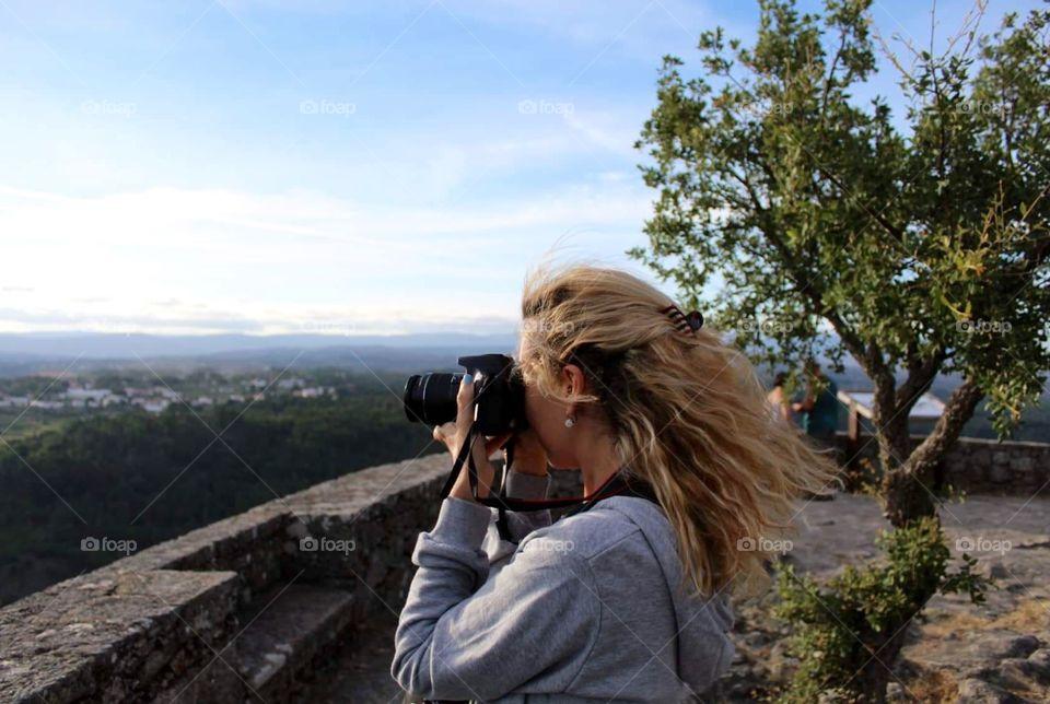 Girl and her camera shooting photos