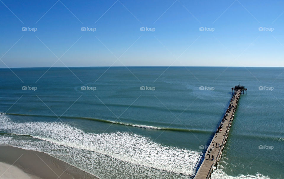 You can see forever! View of Atlantic Ocean and the famous Cherry Grove Fishing Pier in South Carolina.