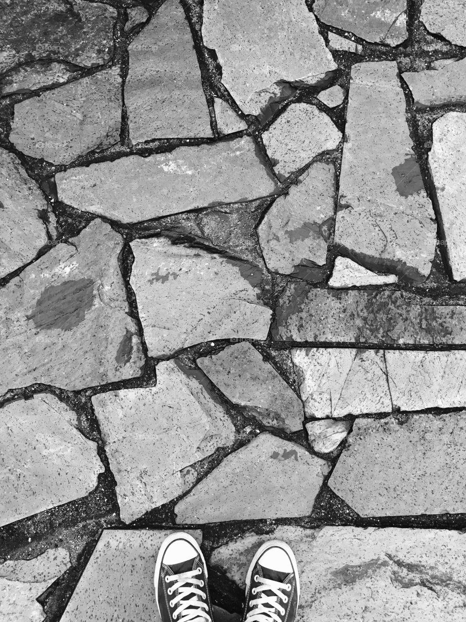 Canvas Shoes on Stone Pavement