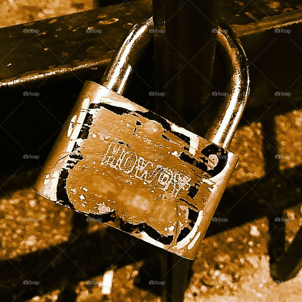 """Nothing says comfort and security like a random lock etched with """"Howdy."""" Haha! Only in Texas."""