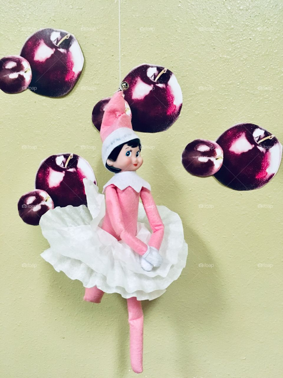 Naughty elf dancing like the Sugar Plum Fairy from the Nutcracker ballet