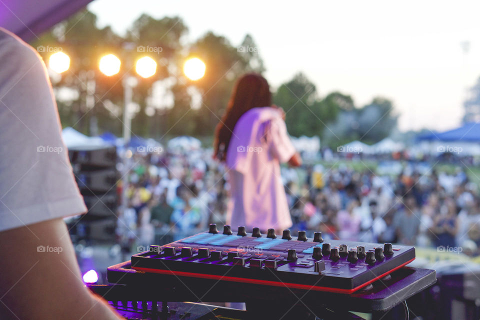 DJ and artist perform for a festival.