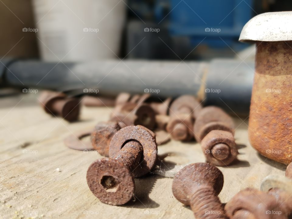 rusty old bolts on wood