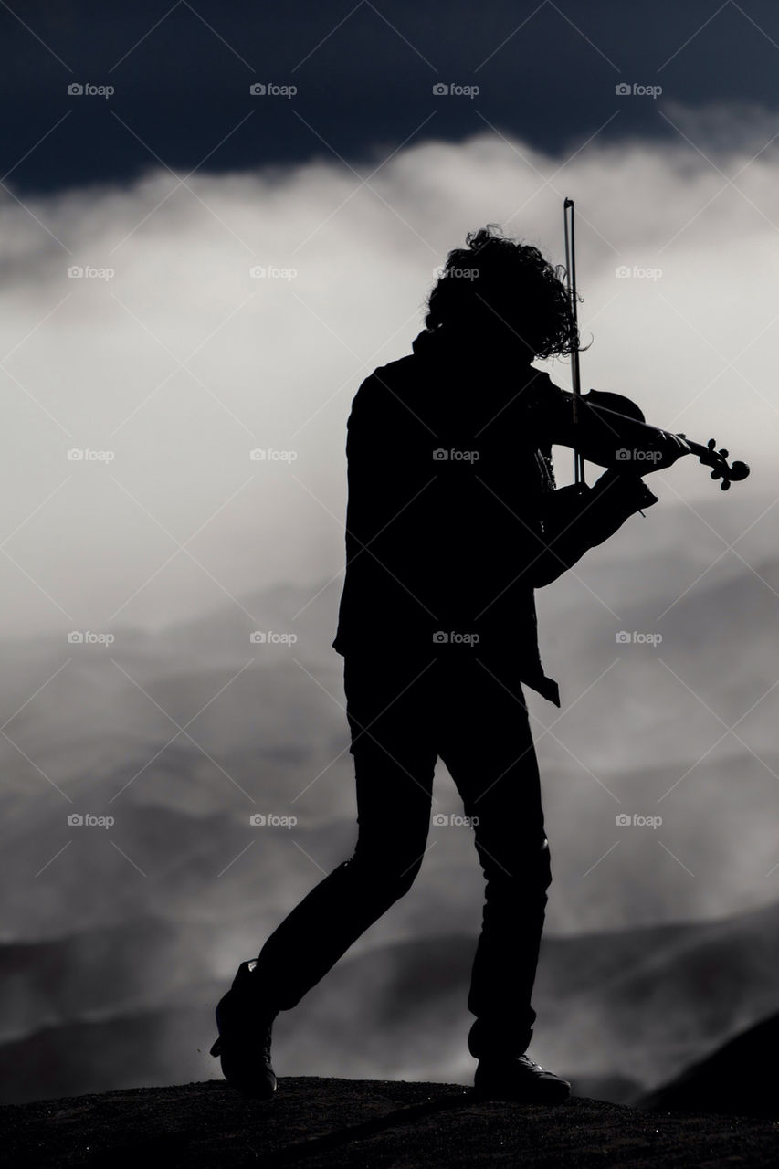 Violinist silhouettes on bromo