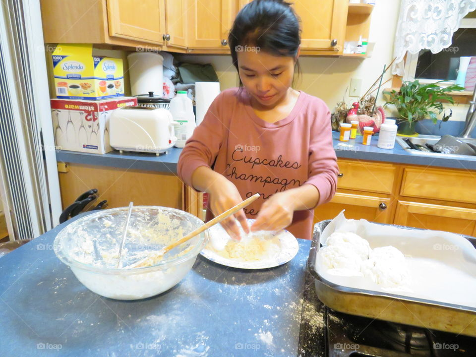Close-up of a girl preparing cake