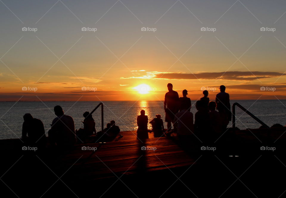 People enjoying the sunset in Malmö, Sweden.