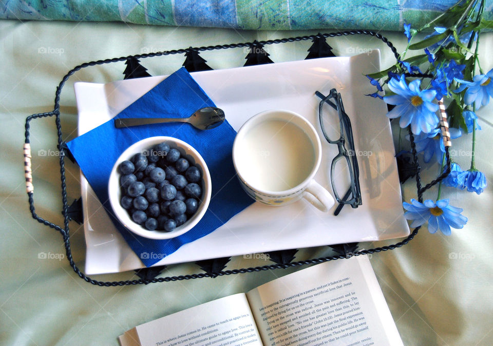 breakfast in bed, blue theme, flat lay, story, book, reading, glasses, blueberry, milk, food tray