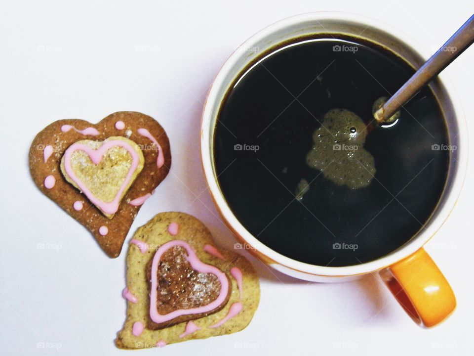 High angle view of coffee and cookies
