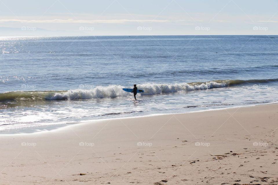 Surfer at Santa Cruz Beach, California