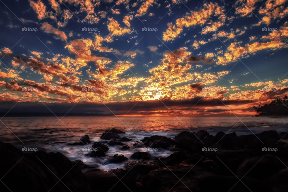 Dramatic sky during sunset over sea