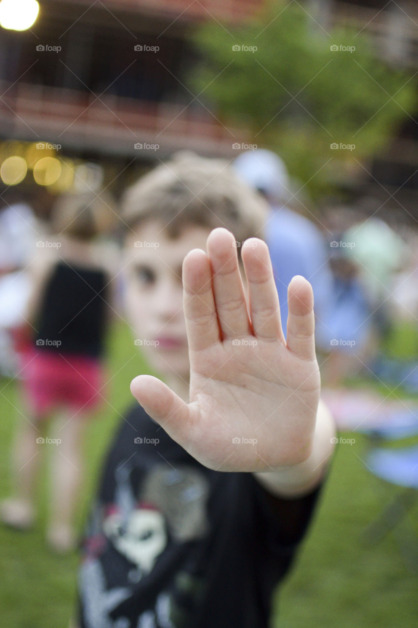Close-up of a boy gesturing