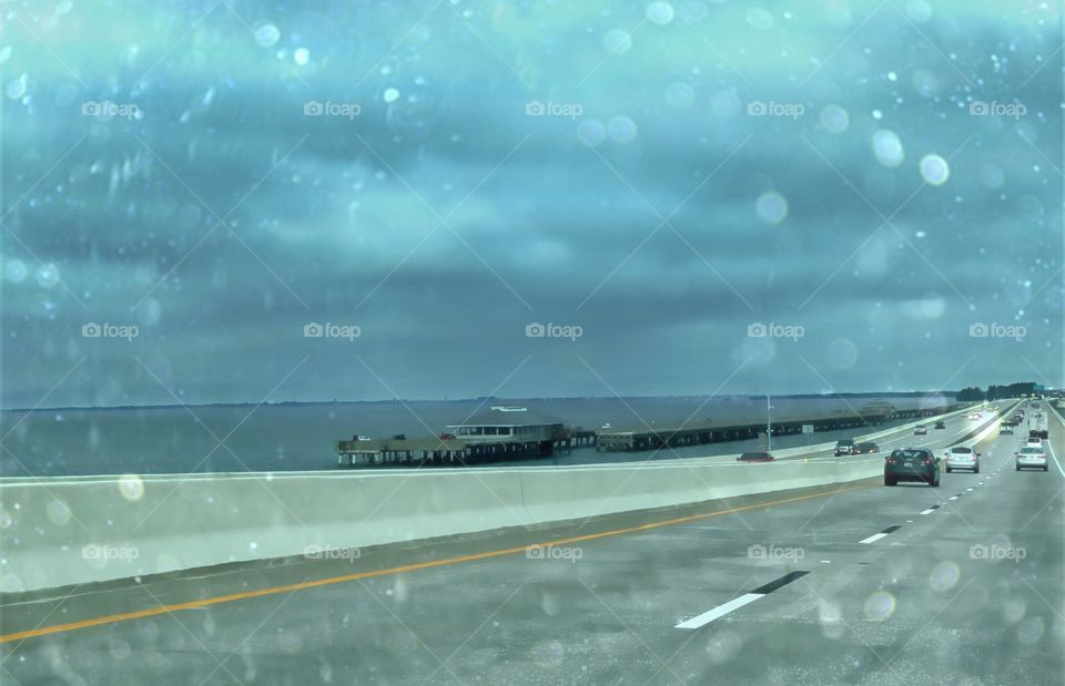 Crossing the Skyway Bridge on a dark rainy day.