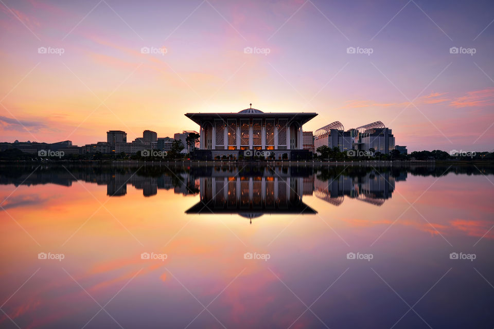 Sunrise reflections over the mosque in Putrajaya Malaysia