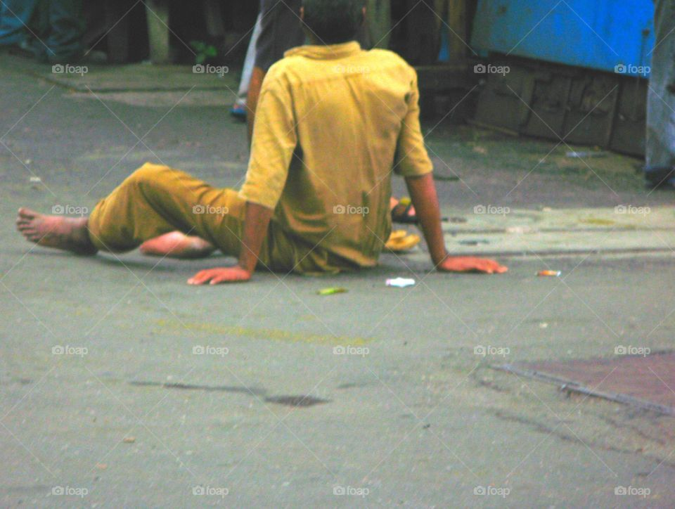 Street misery in India, Mumbai. An image that simultaneously represents despair and acceptance.