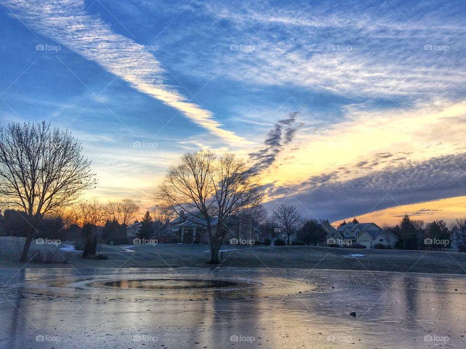 Morning over frozen pond