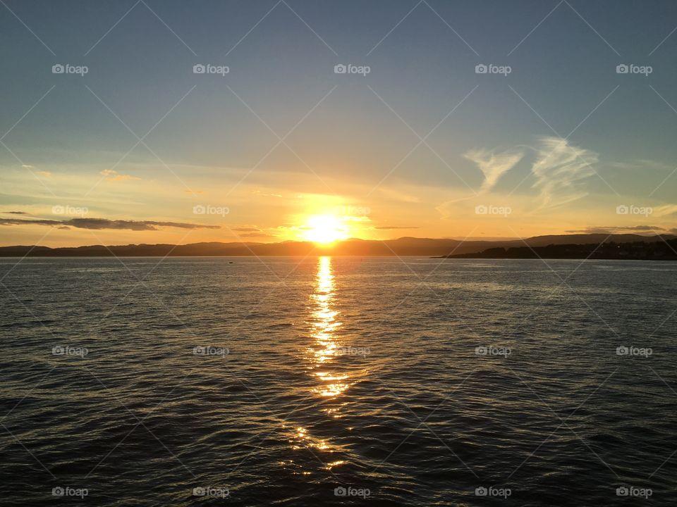 Reflection of orange sunset at sea