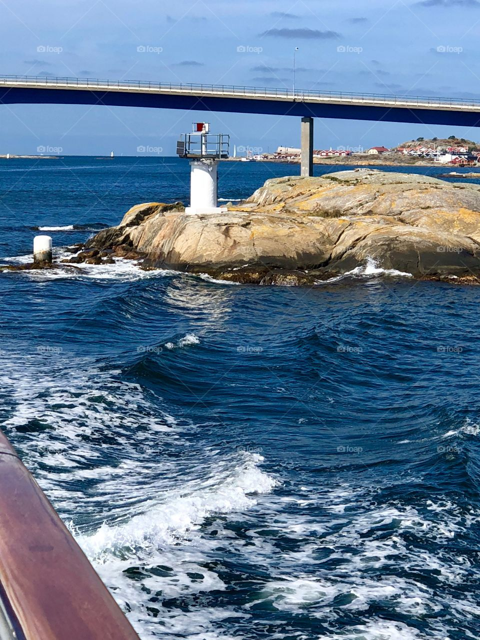 Passing under a bridge and a lighthouse