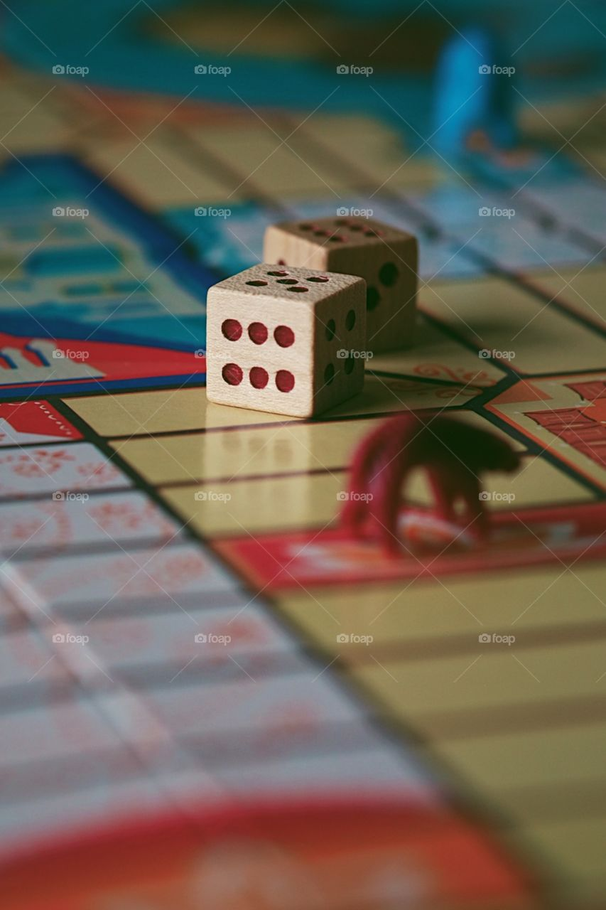 Dice on a board game, Parcheesi board game, pawns on the board game, closeup of a classic game, die on a board game, playing games at home, board games with kids, family time at home