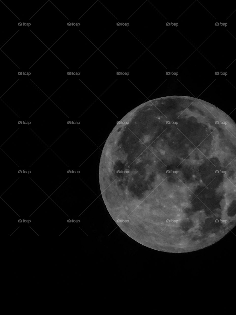 Full moon with Dark Black background having detail structure.