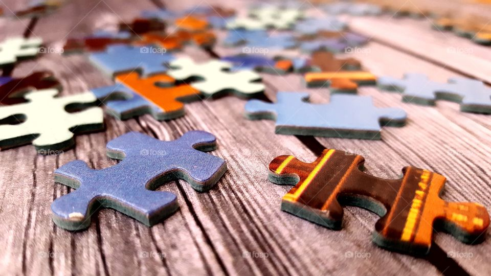 Puzzle pieces on a wooden table