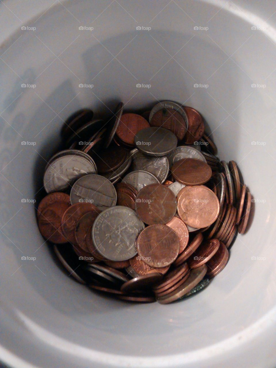 Cup full of coins