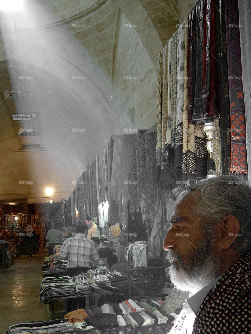 old man under light beam