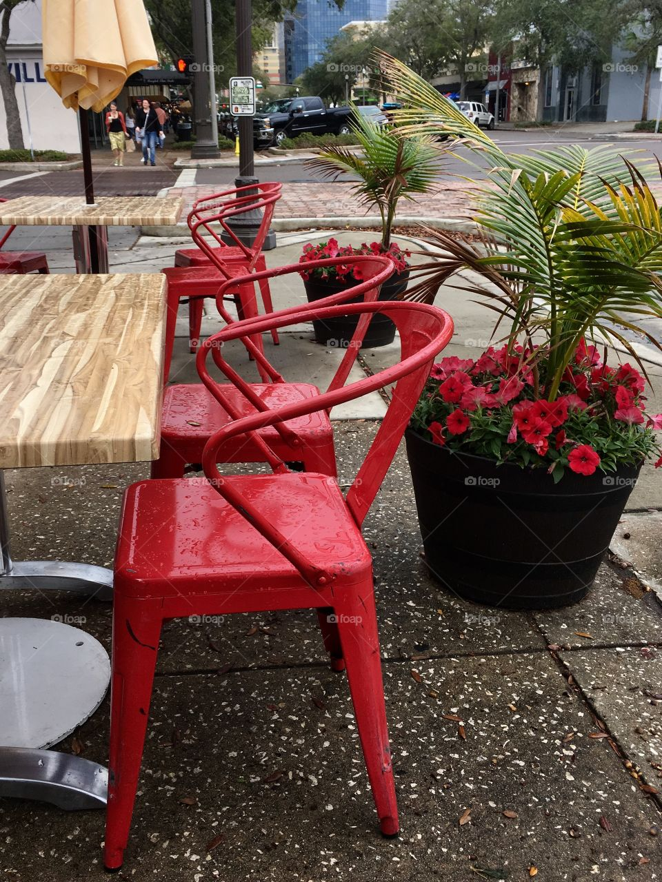 Sidewalk cafe with red chairs