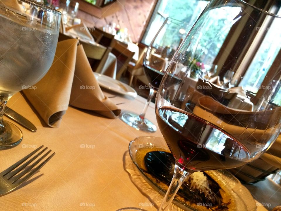 Wine glass on dining table in restaurant