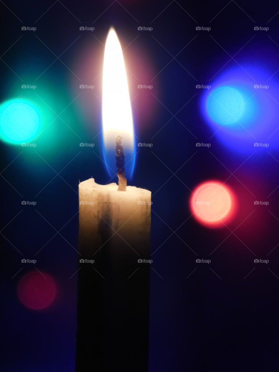 Candle with colourful bookeh effects