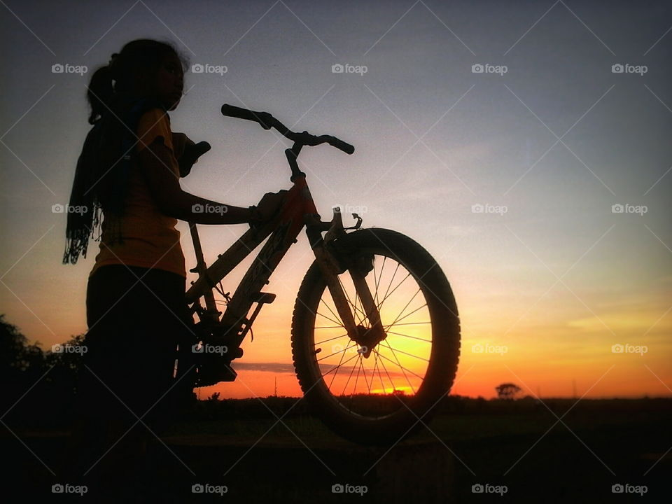A girl with her bike