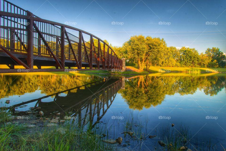 Reflection of bridge in lake