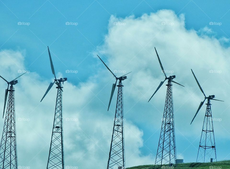 Wind Power Turbines. Spinning Turbines At A California Renewable Energy Site