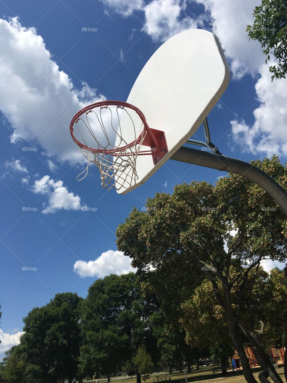 Basketball Net and Blue Sky with Clouds 1
