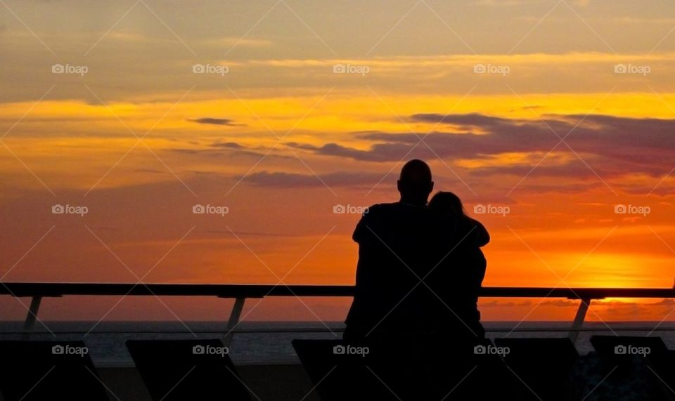 Loving couple in sunset