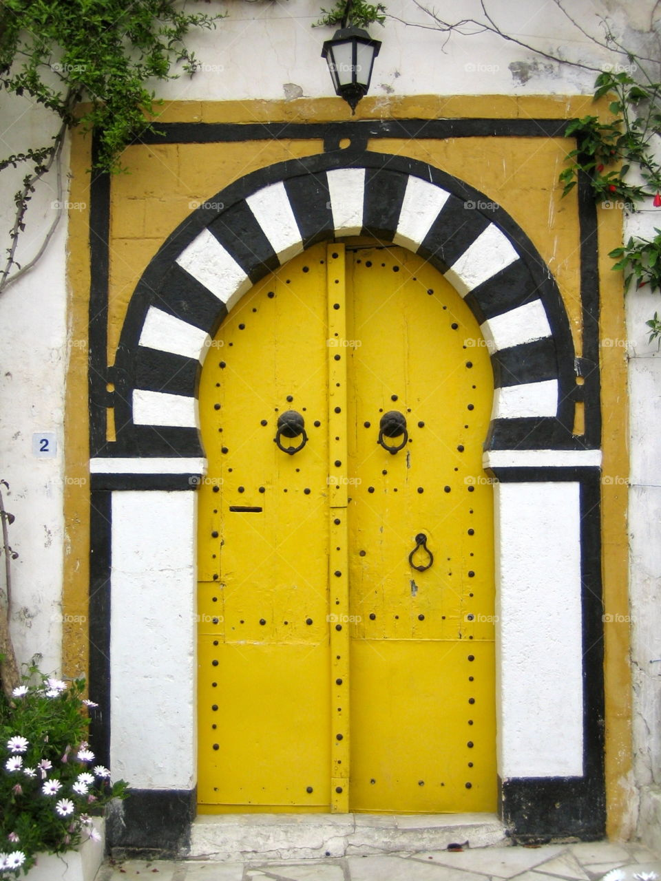 Yellow door. It's always an exciting question: Who lives behind a door and which story could be told?  Seen in Tunisia.