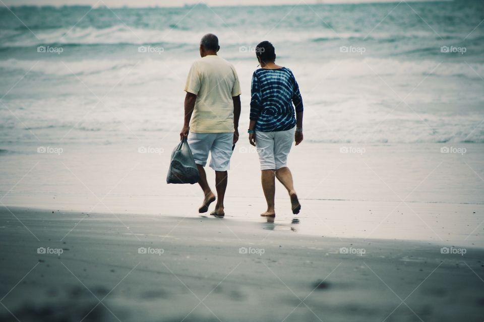 old age elder couple along the beach