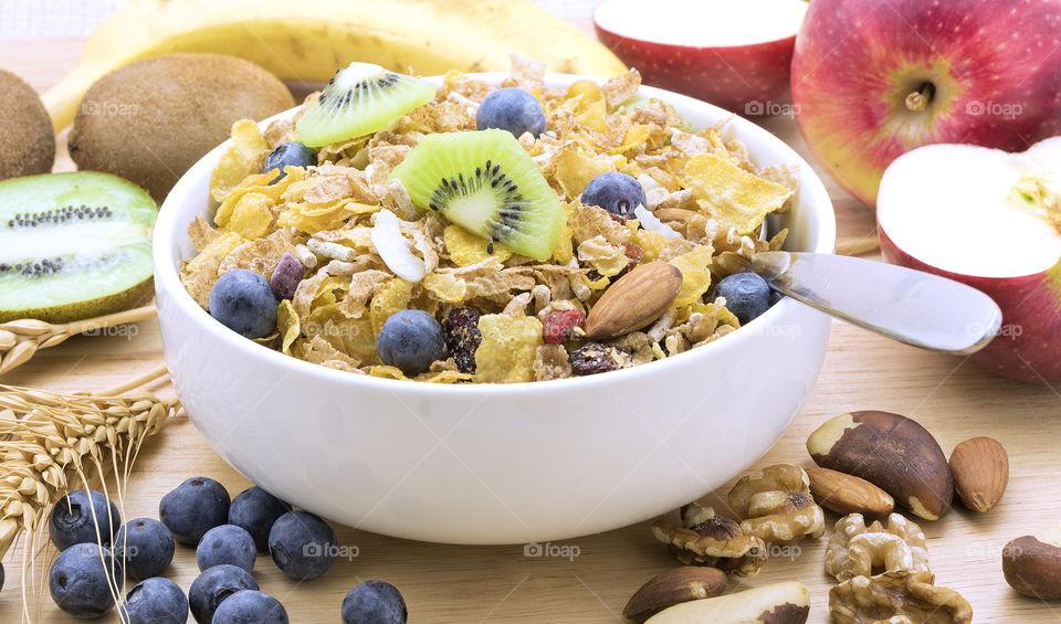 Fresh fruit and wholegrain cereal for breakfast