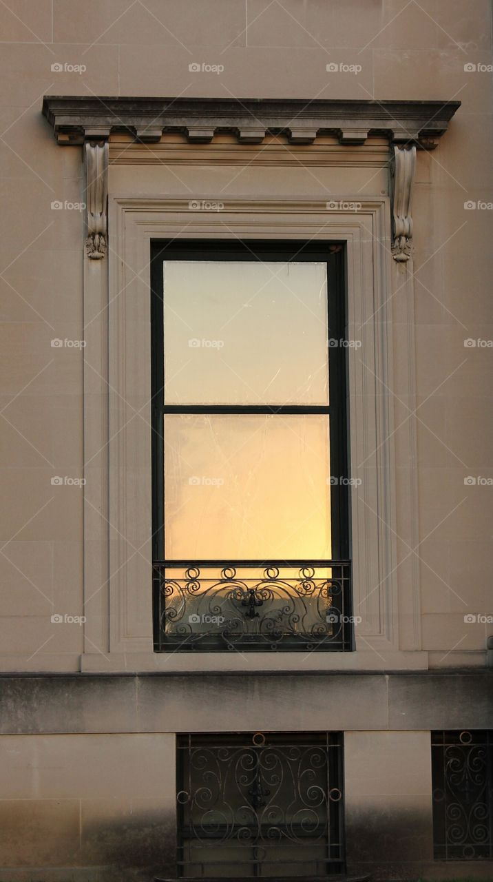 Reflection. Presunset reflecting in a mansion window