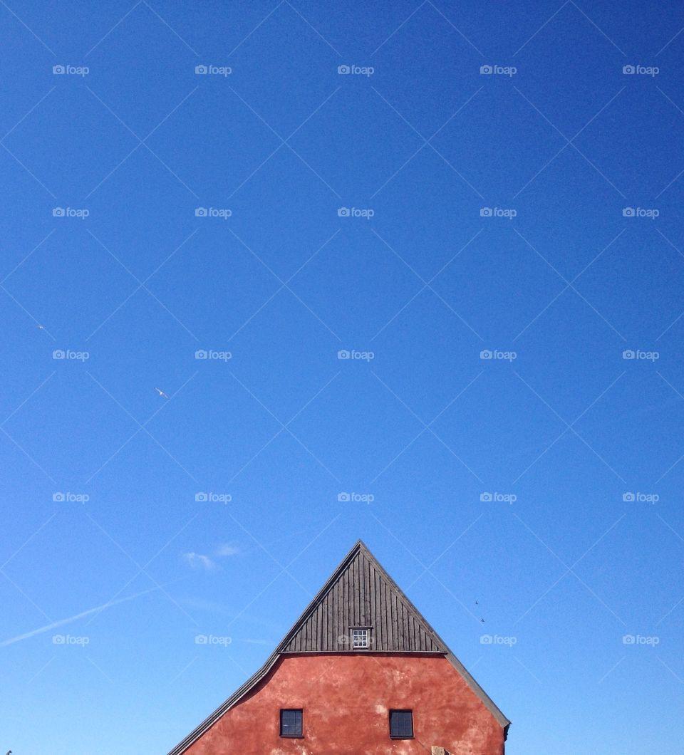 Roof top against summer sky