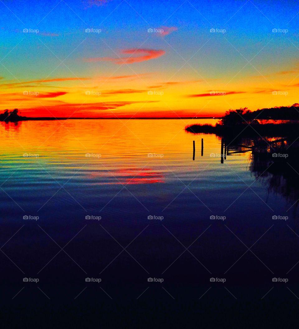 Colorful sunset, on jolly bay northwest Florida