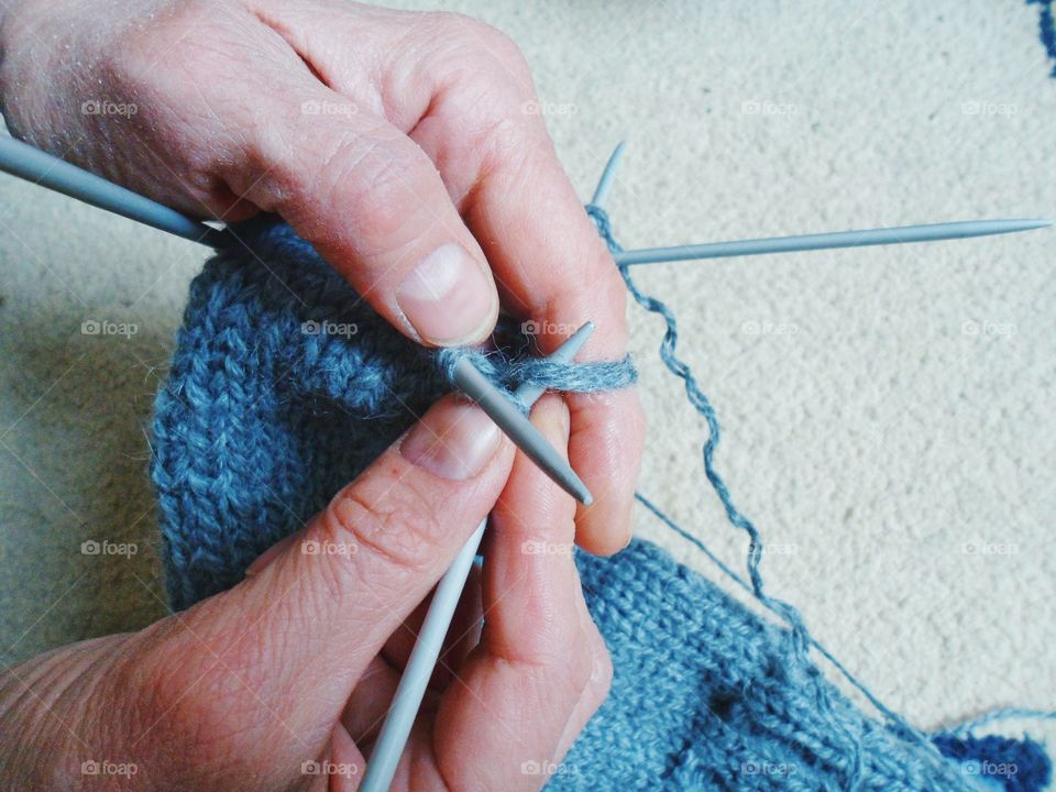 Close-up of hand knitting wooly socks
