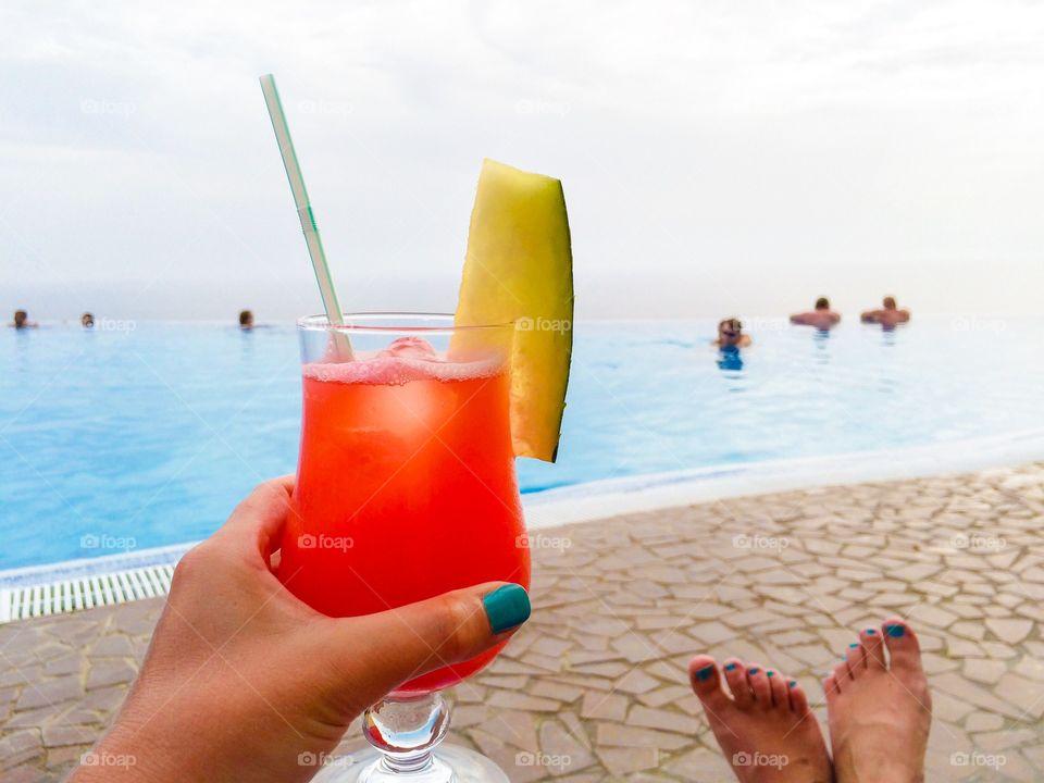 People enjoying near pool