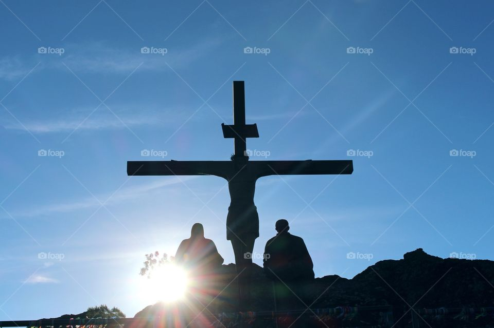 Beautiful view of the cross with the sunset