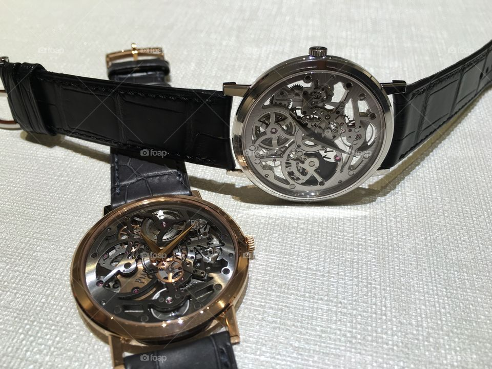 Two wristwatches on table