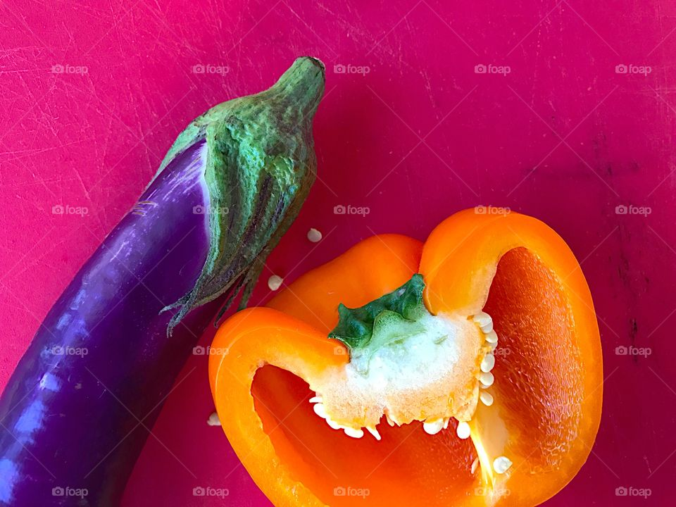 Orange bell pepper and eggplant with copy space