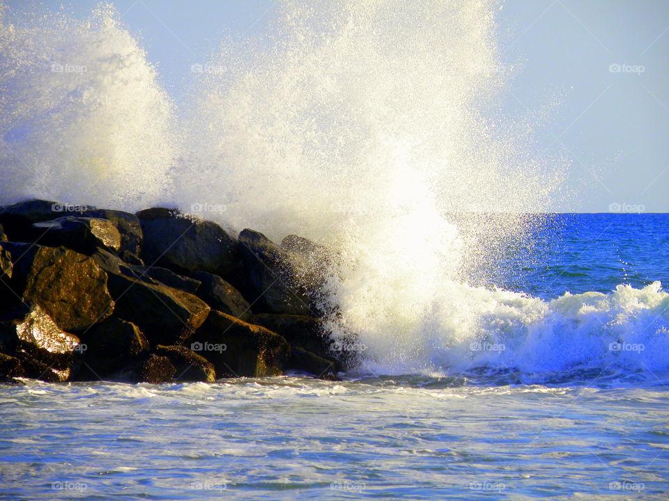 Waves crashing against rock