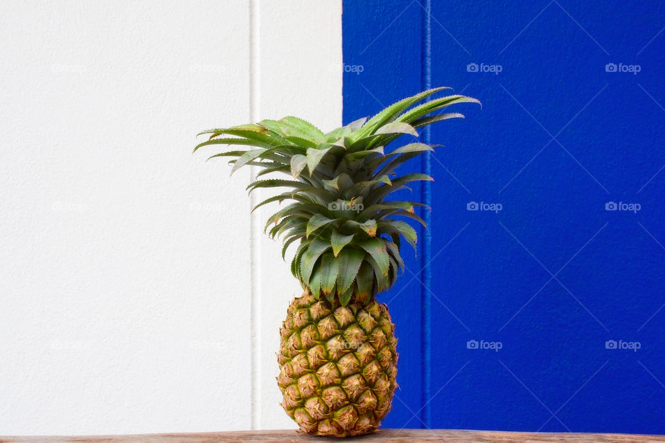 Isolated pineapple on white and blue background