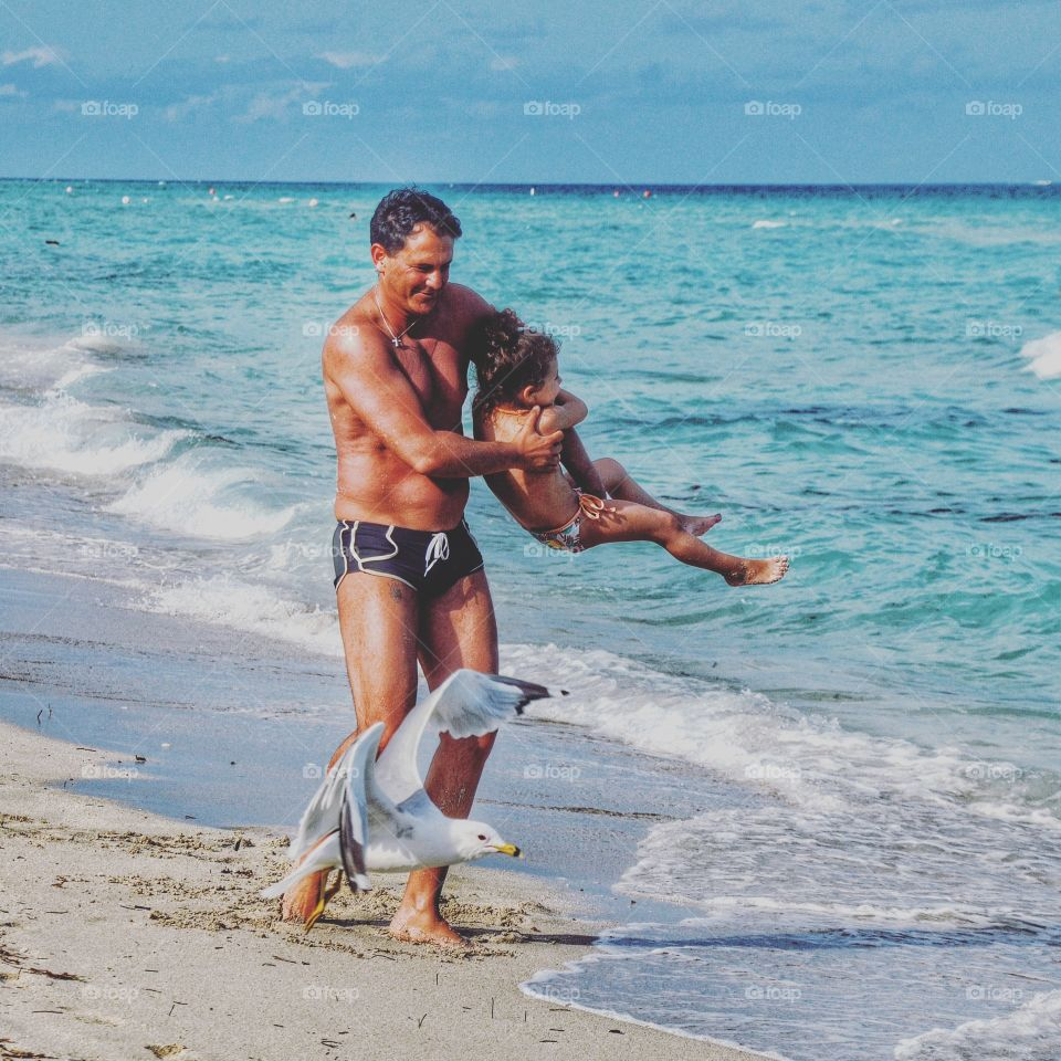 Father- daughter fun at the beach